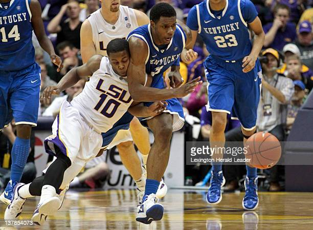 Kentucky Wildcats forward Terrence Jones runs down a loose ball past LSU Tigers guard Andre Stringer during game action at Pete Maravich Assembly...