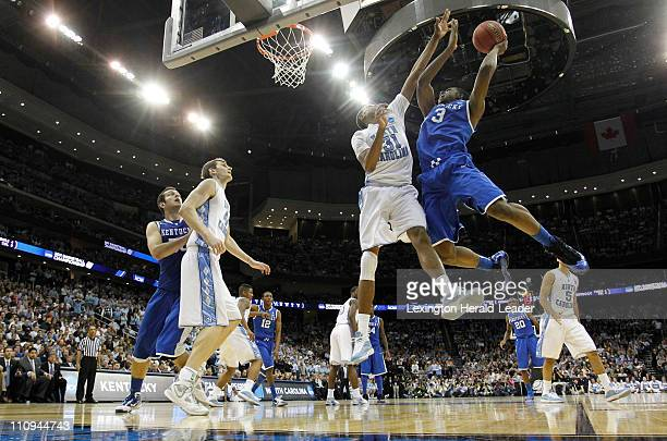 Kentucky Wildcats forward Terrence Jones went hard to the basket against North Carolina Tar Heels forward John Henson during the Elite 8 of the men's...