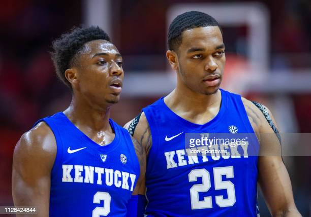 Kentucky Wildcats guard Ashton Hagans and forward PJ Washington walk off the court during a college basketball game between the Tennessee Volunteers...