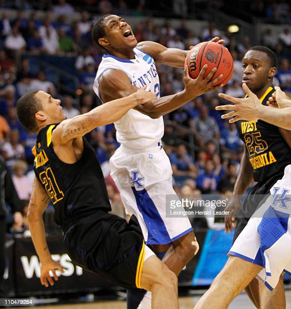 Kentucky Wildcats guard Brandon Knight draws contact with no foul called against West Virginia Mountaineers guard Joe Mazzulla during the third round...