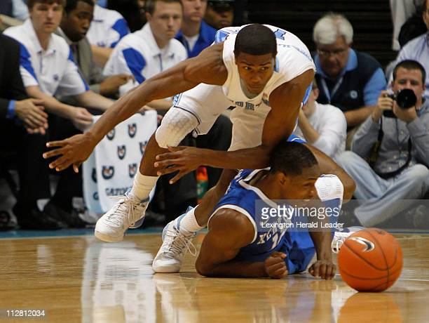 Kentucky Wildcats guard Brandon Knight went to the floor to get a steal from North Carolina Tar Heels guard Dexter Strickland in the first half on...