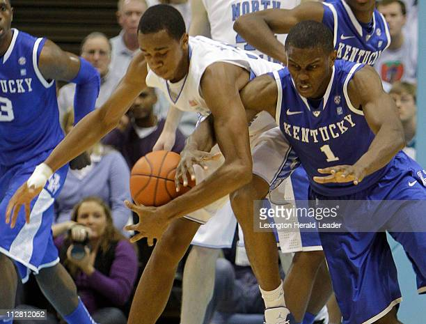 Kentucky Wildcats guard Darius Miller reached in for a steal of North Carolina Tar Heels forward John Henson on Saturday, December 4, 2010 in Chapel...