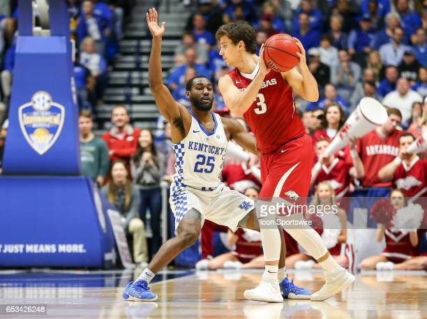 Kentucky Wildcats guard Dominique Hawkins posts up against Arkansas Razorbacks guard Dusty Hannahs during the first half of the Southeastern...