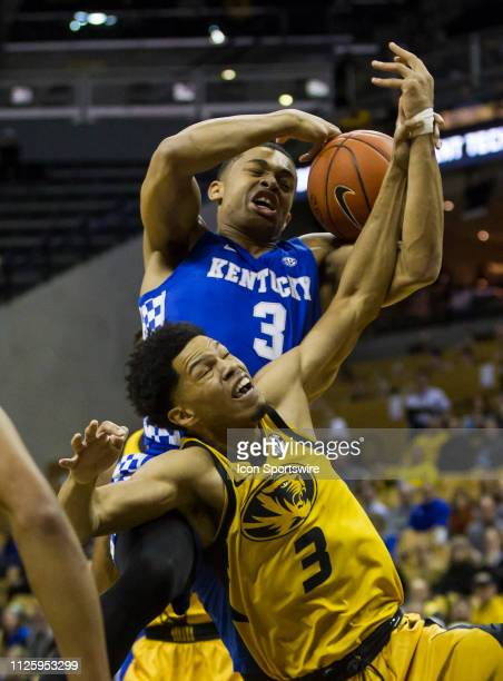 Kentucky Wildcats guard Keldon Johnson and Missouri Tigers guard Ronnie Suggs battle for a rebound during the SEC regular season matchup between the...