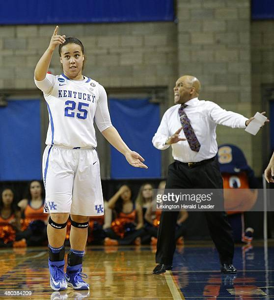 Kentucky Wildcats guard Makayla Epps points to the Kentucky possession arrow while Syracuse Orange head coach Quentin Hillsman disagreed with a call...