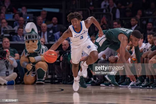 Kentucky Wildcats guard Tyrese Maxey steals the ball away from Michigan State Spartans forward Aaron Henry during the second half of the State Farm...