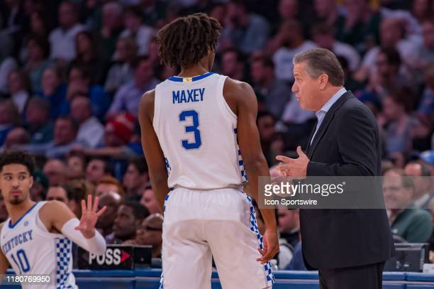Kentucky Wildcats head coach John Calipari talks with guard Tyrese Maxey during the State Farm Champions Classic game between the Michigan State...