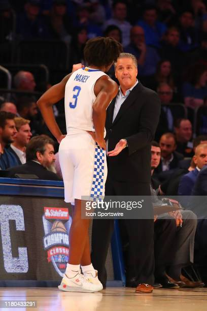 Kentucky Wildcats head coach John Calipari talks with Kentucky Wildcats guard Tyrese Maxey during the first half of the 2019 State Farm Champions...