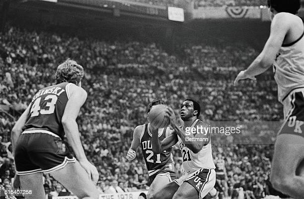 Kentucky Wildcats Jack Givens takes aim before shooting as he is guarded by Duke's Bob Bander in the second half of their NCAA championship game...