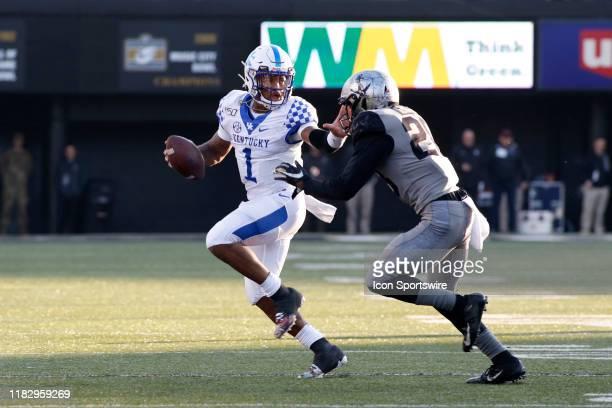 Kentucky Wildcats quarterback Lynn Bowden Jr stiff arms Vanderbilt Commodores defensive back Allan George during a game between the Vanderbilt...