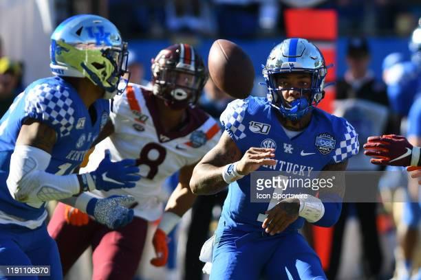Kentucky Wildcats quarterback Lynn Bowden Jr tosses the ball back to Kentucky Wildcats running back Asim Rose during the Belk Bowl between the...
