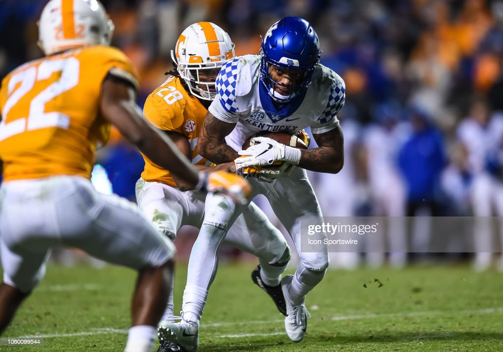 Kentucky Wildcats quarterback Terry Wilson is tackled by ...