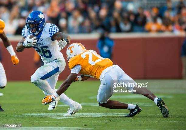 Kentucky Wildcats running back Benny Snell Jr runs past Tennessee Volunteers defensive back Bryce Thompson during a college football game between the...