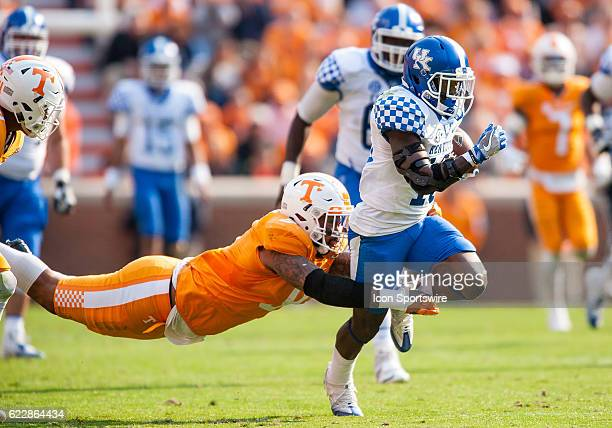 Kentucky Wildcats running back Stanley Williams is caught from behind by Tennessee Volunteers defensive end Derek Barnett during a game between the...