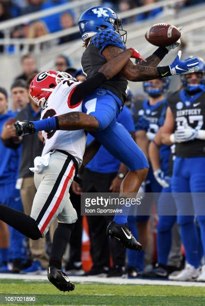 Kentucky Wildcats wide receiver Lynn Bowden Jr gets a hand on the ball as he is hit by Georgia Bulldogs defensive back Tyrique McGhee during the SEC...