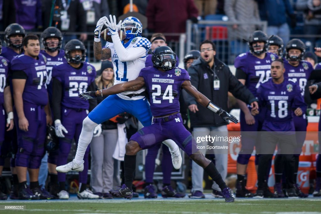 Kentucky Wildcats wide receiver Tavin Richardson with a reception (11) and Northwestern Wildcats corner back Montre Hartage (24) during the Music City Bowl between the Kentucky Wildcats and the Northwestern Wildcats on December 29, 2017 at Nissan Stadium in Nashville, TN.