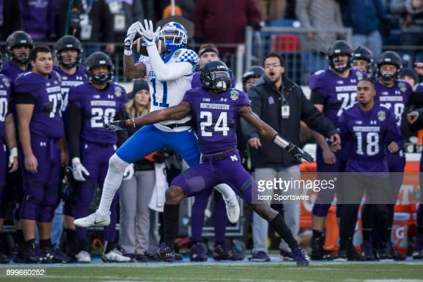 Kentucky Wildcats wide receiver Tavin Richardson with a reception and Northwestern Wildcats corner back Montre Hartage during the Music City Bowl...