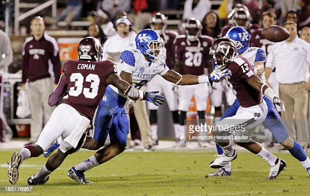 Kentucky's AJ Legree fumbled the ball before recovering it while pursued by Mississippi State's Kivon Coman and Cedric Jiles in the fourth quarter at...