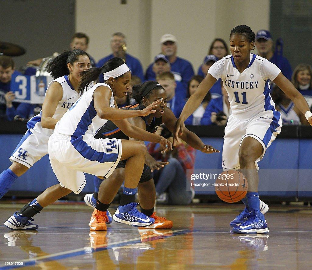 Kentucky's Bria Goss (13) steals the ball from Florida's January Miller as Kentucky's Jennifer O'Neill (0) and DeNesha Stallworth (11) apply pressure at Memorial Coliseum in Lexington, Kentucky, on Thursday, January 3, 2013.