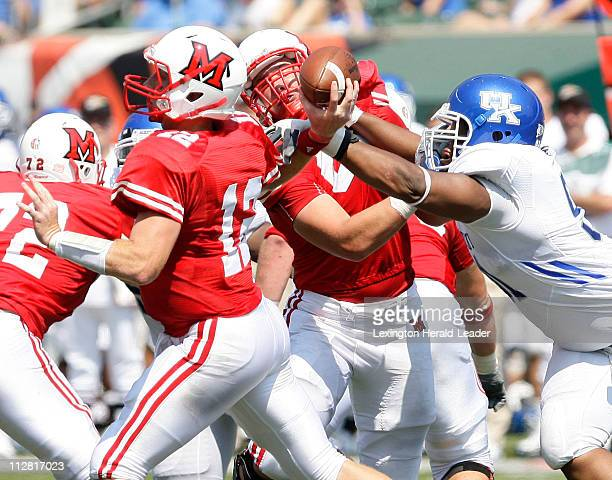 Kentucky's Corey Peters grabs the arm of Miami of Ohio quarterback Daniel Raudabaugh that forces an incompletion. The Wildcats defeated the RedHawks,...