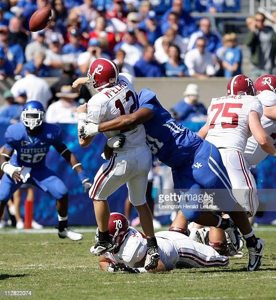 Kentucky's Corey Peters hits Alabama quarterback Greg McElroy, Saturday, October 3 in Lexington, Kentucky. The Crimson Tide defeated the Wildcats,...