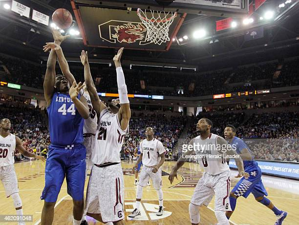 Kentucky's Dakari Johnson has his shot blocked by South Carolina's Mindaugas Kacinas as Demetrius Henry defends in the second half at Colonial Life...