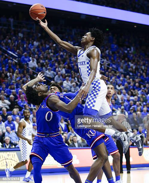 Kentucky's De'Aaron Fox, top, is called for a charge on the drive over Kansas guard Josh Jackson on Saturday, Jan. 28 at Rupp Arena in Lexington, Ky....