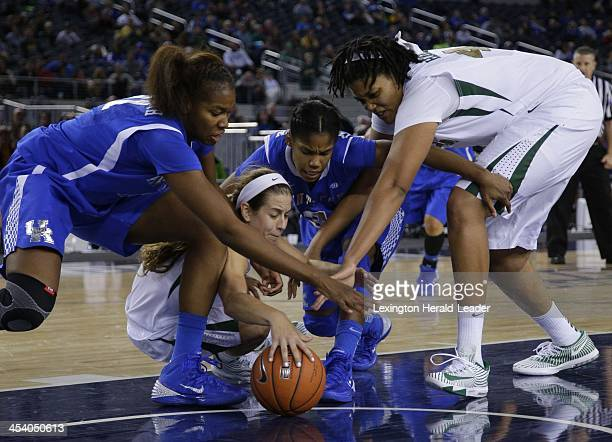 Kentucky's DeNesha Stallworth left and Janee Thompson battle Baylor's Makenzie Robertson and Kristina Higgins right for a loose ball as Kentucky won...
