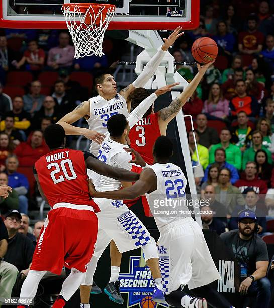 Kentucky's Derek Willis and Jamal Murray pressure a shot by Stony Brook's Kameron Mitchell during the first half in the first round of the NCAA...