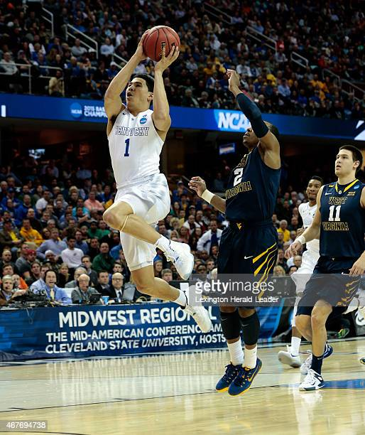 Kentucky's Devin Booker scores on a drive past West Virginia's Jevon Carter in the first half of the NCAA Tournament Sweet 16 game in the Midwest...