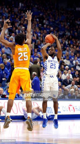 Kentucky's Dominique Hawkins launches a 3pointer in front of Tennessee's Shembari Phillips in the first half at Rupp Arena in Lexington Ky on Tuesday...