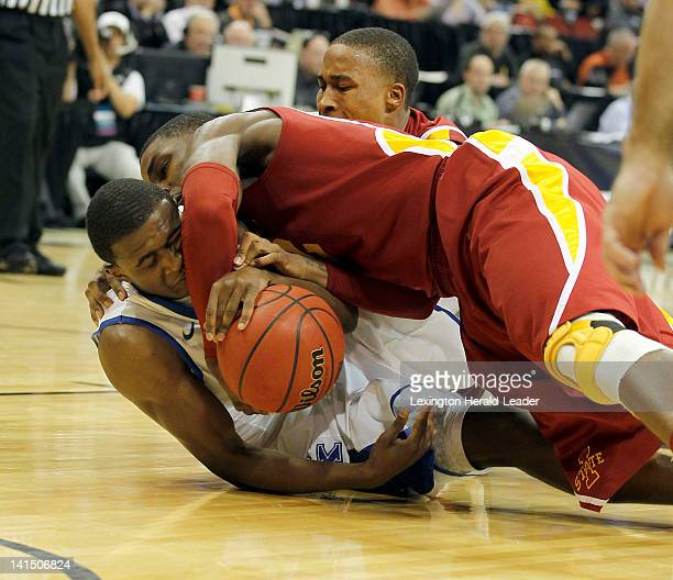 Kentucky's Doron Lamb and Iowa State's Anthony Booker scramble for a loose ball during the first half of a thirdround game in the NCAA Tournament at...