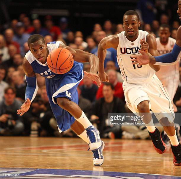 Kentucky's Eric Bledsoe, and Connecticut's Kemba Walker go after a loose ball in the SEC-Big East Invitational at Madison Square Garden in New York,...
