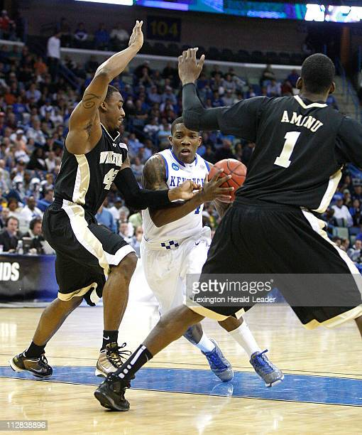 Kentucky's Eric Bledsoe, center, drives between Wake Forest defenders L.D. Williams and 1- Al-Farouq Aminu during first-half action in a second-round...