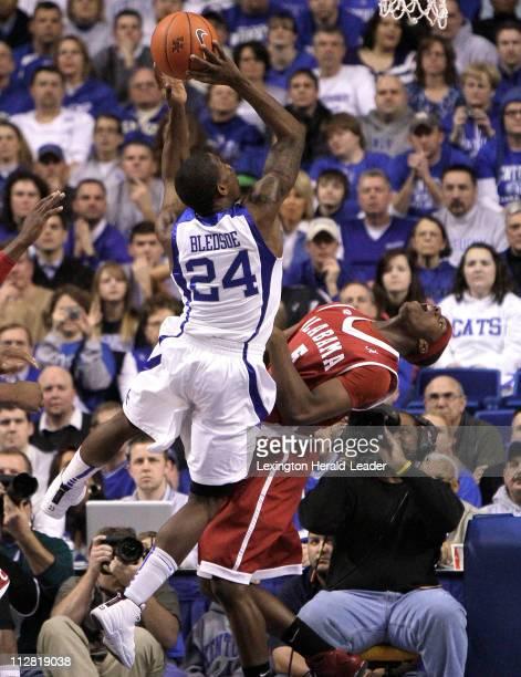 Kentucky's Eric Bledsoe draws a foul on Alabama's Tony Mitchell at Rupp Arena in Lexington, Kentucky, on Tuesday, February 9, 2010. Kentucky beat...