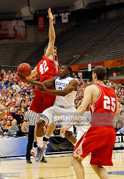 Kentucky's Eric Bledsoe drives against Cornell's Mark Coury in the men's NCAA Basketball Tournament in Syracuse, New York, Thursday, March 25, 2010.