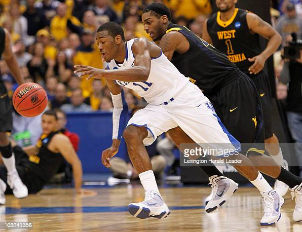 Kentucky's John Wall chases down the ball in front of West Virginia's Jonnie West during firsthalf action in the NCAA East Regional at the Carrier...