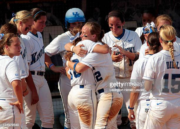 Kentucky's Meagan Aull left and Megan Yocke hugg after loosing 90 in the final game of the NCAA Super Regional in Lexington Kentucky Sunday May 29...