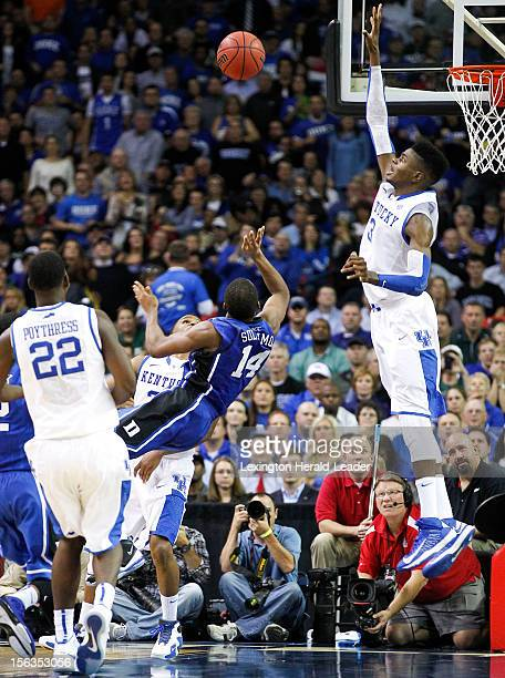 Kentucky's Nerlens Noel, right, blocks a shot by Duke's Rasheed Sulaimon in the State Farm Champions Classic on Tuesday, November 13 at the Georgia...