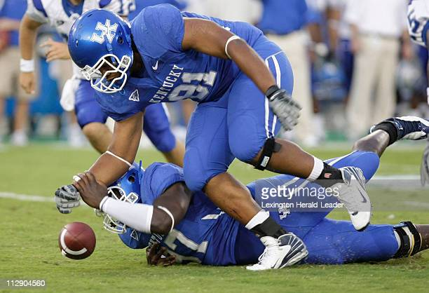 Kentucky's Nii Adjei Oninku bottom and Corey Peters top tried to run down a fumble by Middle Tennessee State's Sancho McDonald in the second quarter...