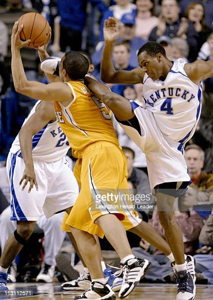 Kentucky's Rajon Rondo comes down on Tennessee's Chris Lofton after Lofton faked a shot on the way to the basket in the second half during...