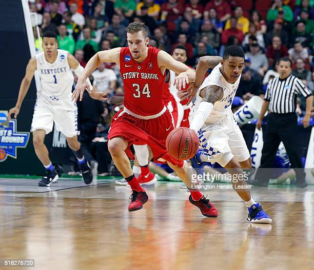 Kentucky's Tyler Ulis makes a steal from Stony Brook's Lucas Woodhouse during the first half in the first round of the NCAA Tournament at the Wells...