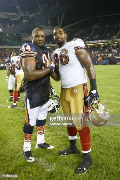 Kentwan Balmer of the San Francisco 49ers with Marcus Harrison of Chicago Bears at Soldier Field after the NFL game on August 21 2008 in Chicago...