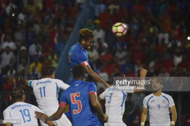 Kenvens Belfort of Haiti vies for the ball during the first of two match to define the last qualified to the 2017 Gold Cup at the Sylvio Cator...