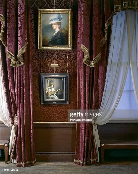 Kenwood House c19902010 The Iveagh Bequest London A view of the Dining Room displaying ' Mrs Musters ' by George Romney and ' The Guitar Player ' by...