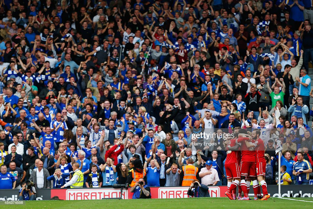 Kenwyne Jones of Cardiff City celebrates with teammates after scoring the equalising goal during the Sky Bet Championship match between Fulham and Cardiff City at Craven Cottage on August 30, 2014 in London, England.