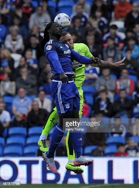Kenwyne Jones of Cardiff City challenges for the ball with Joel Lynch of Huddersfield during the Sky Bet Championship match between Cardiff City and...