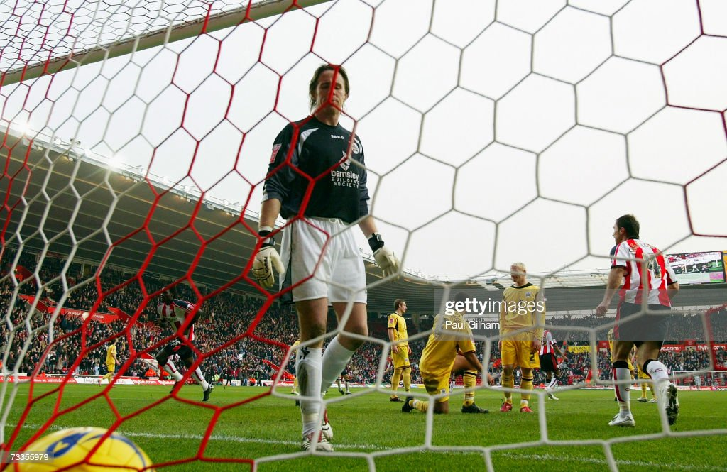 Kenwyne Jones of Southampton (L) celebrates scoring the second goal for Southampton as goalkeeper Nick Colgan of Barnsley makes his way to collect the ball from the back of the net during the Coca-Cola Championship match between Southampton and Barnsley at St Mary's Stadium on February 17, 2007 in Southampton, England.