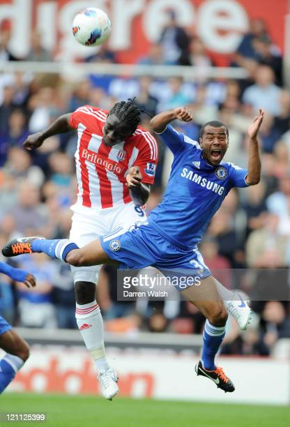 Kenwyne Jones of Stoke and Ashley Cole of Chelsea compete for a header during the Barclays Premier League match between Stoke City and Chelsea at the...