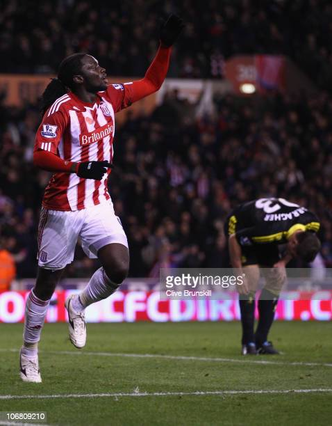 Kenwyne Jones of Stoke City celebrates after scoring the second goal as Jamie Carragher of Liverpool shows his dejection during the Barclays Premier...